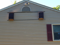 Two 3 Cell Bat Houses Mounted On Wall Of House